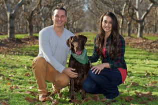 Chris, Chelsea and their chocolate lab Toa