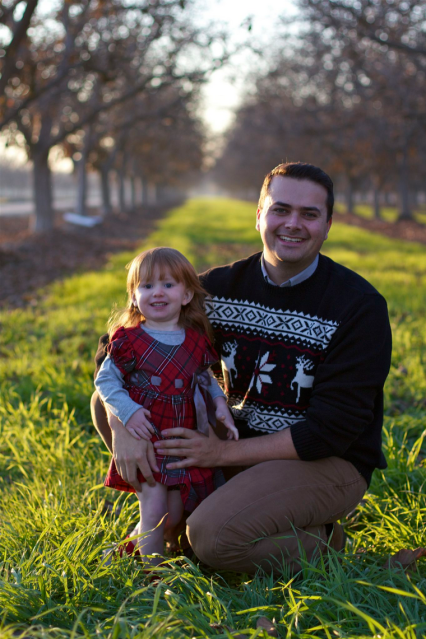 Jon and daughter Kaydence Christmas portrait