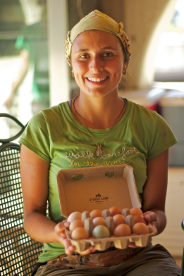 WWOOFer Melissa from Columbia with a dozen pastured chicken eggs