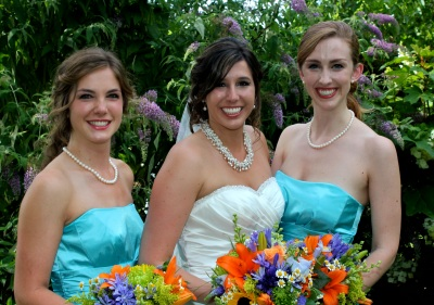 Kayla and her new sisters-in-law pose after the ceremony.
