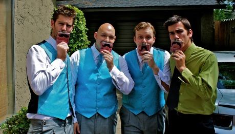 Jonathan's wedding gifts were custom mustache flasks.