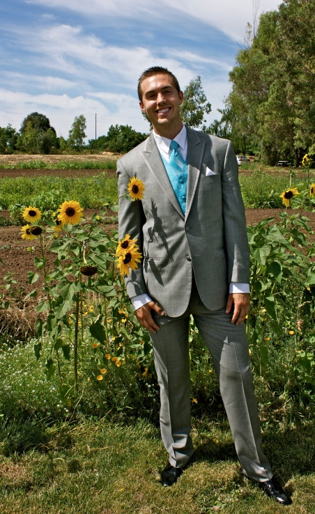 Jonathan & Kayla were married in a beautiful country setting with many blooming sunflowers around.