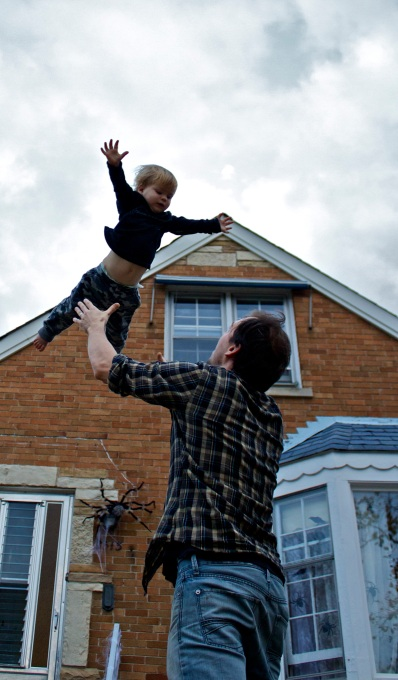 Daniel sends trusting young Noah skyward outside their Skokie, IL home.